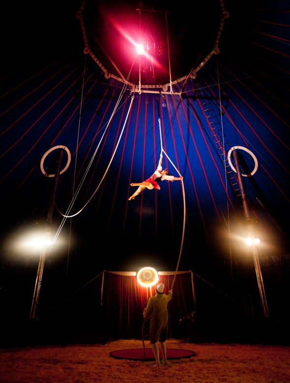 Clown Jay Walter (bottom) controls the rope while his wife, Tosca Zoppé performs her aerial routine at the Zoppé Family Circus in Westhampton Beach, July 25, 2013. Photo by Jeffrey Basinger / Newsday